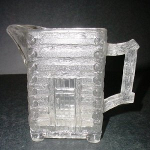 Tall Log Cabin in the form of a Pitcher