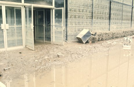 [Flood-damaged exterior of Corning Glass Center] [slide].