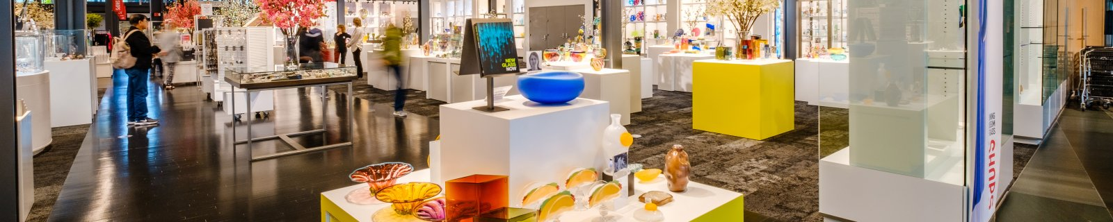 Wide view of glass art for sale in a museum gift shop