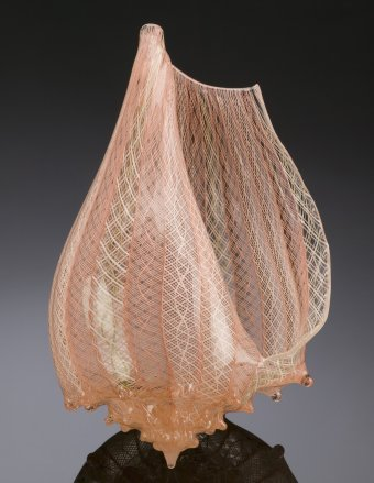 Clear and orange glass conch shell sculpture