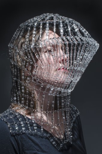 clear flameworked glass armour over a person's face