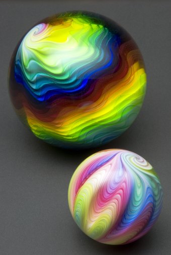 Solid glass spheres with rainbow colors encased.