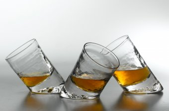 three angled glass whiskey glasses