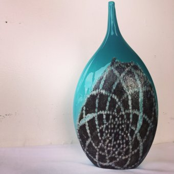 Teal vase with black and white decoration by Cat Burns