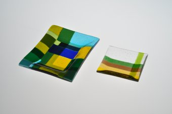 Two Fused colorful, geometric fused glass platters.