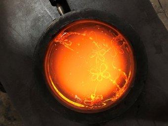 Molten glass in a steel ladel.