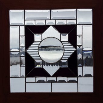 Geometric stained glass window in clear and black glass.