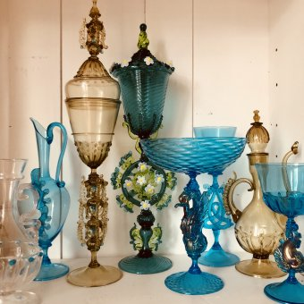 A collection of Venetian-style hand blown blue and amber goblets and decanters.