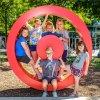 Five children pose in the Museum's hot spot sculpture