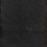 [Black pocket-sized flip-open notebook].