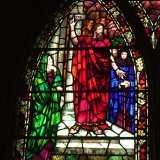 """Eastman Memorial Window designed by Whitefriars and installed in Park Church in Elmira, NY. The window's title is """"Paul Preaching On Mars Hill,"""" as the man standing atop the steps, preaching before a crowd, is likely Saint Paul."""