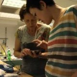 AIDA Scholarship recipient Lisbeth Biger studies pâte de verre with the Higuchis