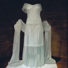 Evening Dress with Shawl Karen LaMonte (American, b. 1967) Czech Republic, Zelezny Brod, 20004 Mold-melted, ground, polished assembled H. 150 cm Collection of The Corning Museum of Glass, gift in part of the Ennion Society (2005.3.21)