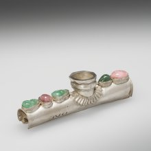 Part of a silver opium pipe with mounted glass gems. China, probably about 1800.