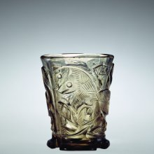 Hedwig Beaker, Origin uncertain, 12th to early 13th century. Colorless glass with a smoky topaz tint; blown, wheel-cut, ground. H. 8.7 cm; Diam (rim). 7.1 cm.  Collection of the Corning Museum of Glass (67.1.11)
