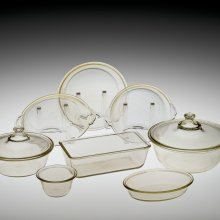 Eight of the first twelve pieces of Pyrex-brand ovenware; 2 Covered Casseroles (#101 and #103); Loaf Pan (#212); Pie Plate (#202); Shirred Egg Dish (#301); Au Gratin Dish (#322); Baking Dish (#400); and Custard Cup (#423); Corning Glass Works, USA, 1915-1919. Gift of Jerry E. Wright. 96.4.167-175.