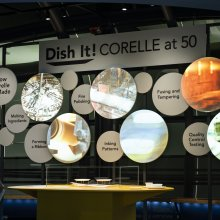 Dish It! Corelle at 50 screens highlighting various steps of manufacturing.