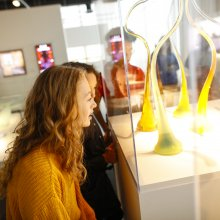 Children smile as the gaze at Studio glass works in the Contemporary Glass gallery.