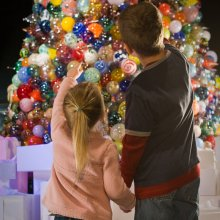 Children Looking at Ornament Tree