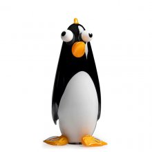 A black and white glass cartoon-like penguin with yellow flippers and beak stands in front of a white background.