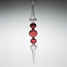Glass ornament with red and white stripes in the middle