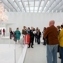 Visitors getting a tour of the Contemporary Art + Design Gallery
