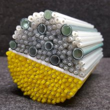 Bundle of yellow and gray canes that will be used to make murrine.