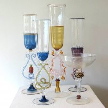 Five colorful glass goblets with elaborately decorated stems