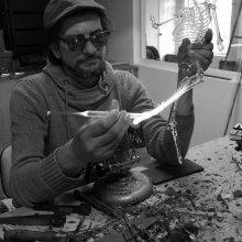 Flameworker John Zinner makes a glass skeleton